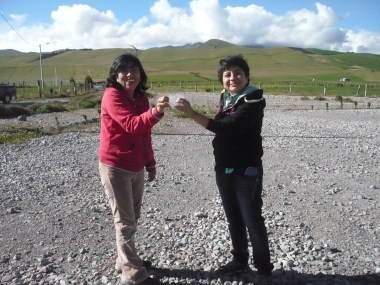 me and my aunt holding a block of ice harvested from the mountain.