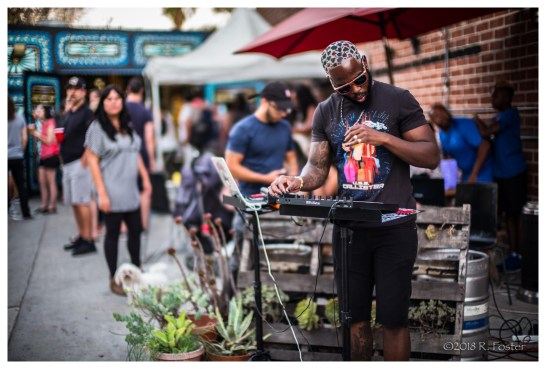 The DJ gettin' it on at the Spoke Bicycle Cafe, 2018 Frogtown Art Walk