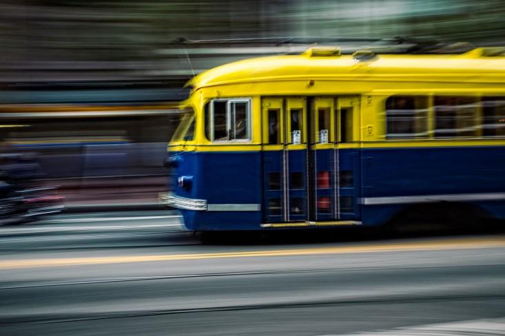 A San Francisco trolley car zipping along Market Street