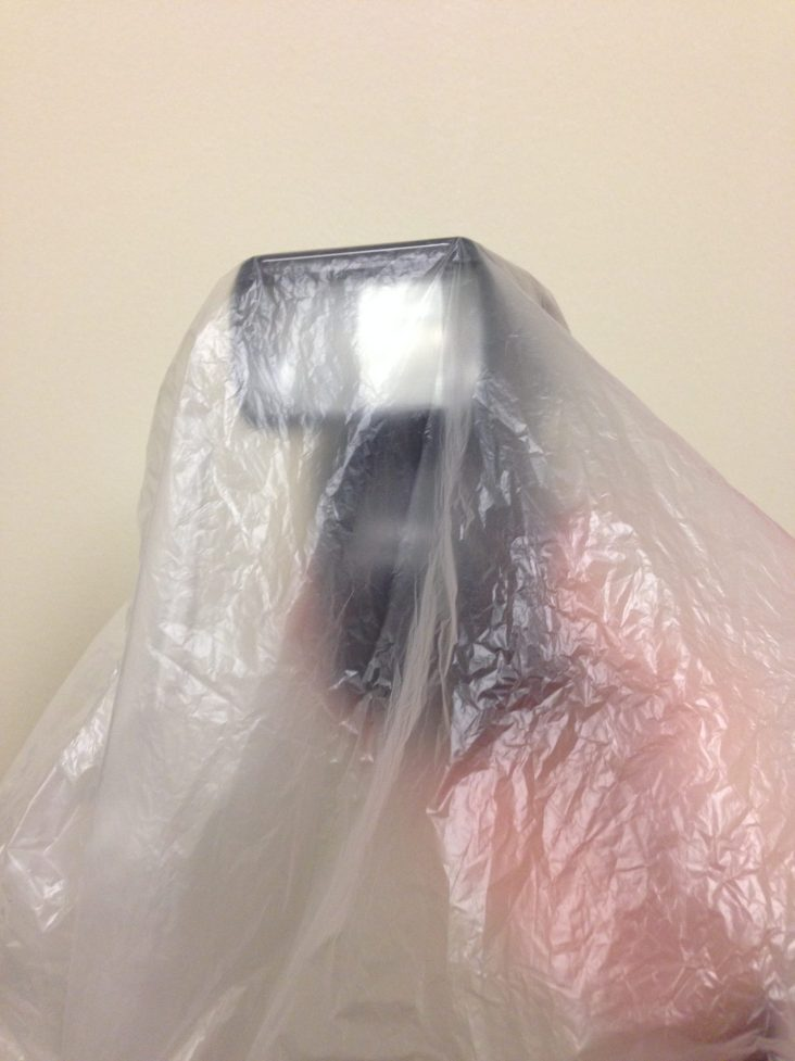 Use a transparent wast basket liner to protect your strobes without breaking the bank.