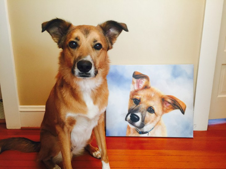 This is my dog, Kodak, sitting next to his puppy painting from Pixelist.