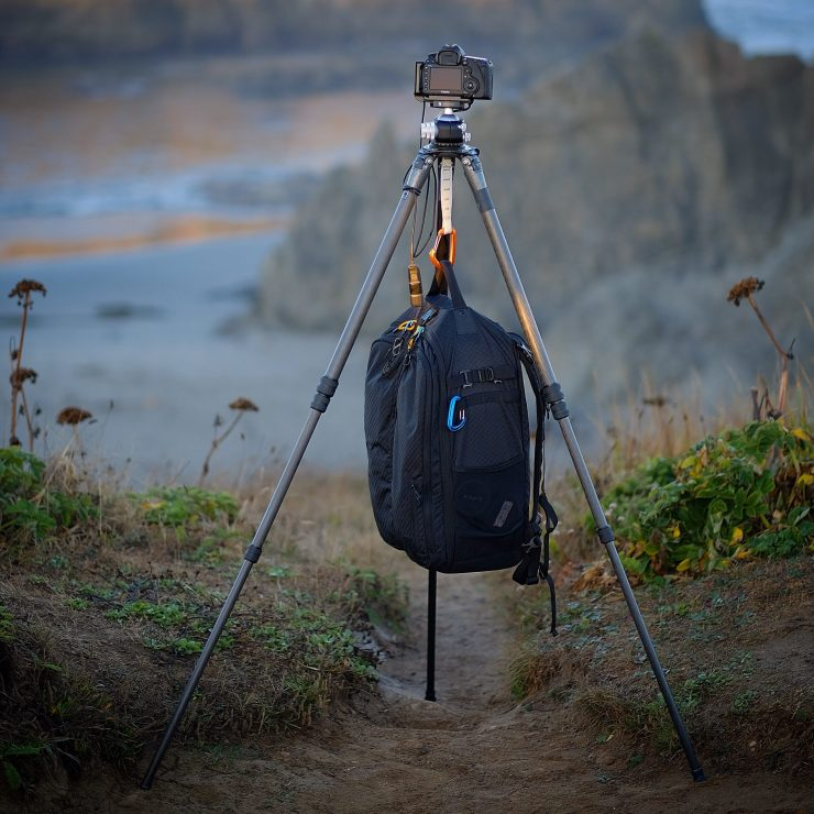 A loaded camera bag slung underneath a stable tripod will add even more stability.