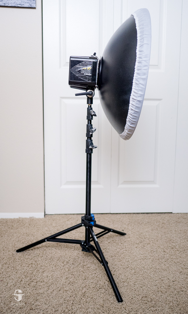 This is the wrong way to position a light stand, with the heaviest part of the light over the empty space between legs.