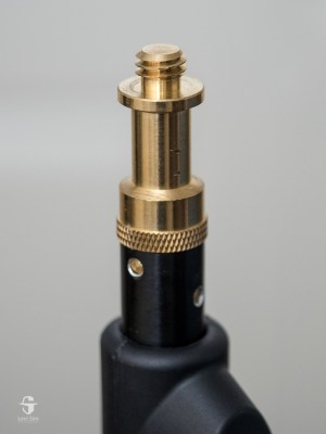 Brass studs reduce the chance of the light rotating because the mounting screw will bite into the brass.