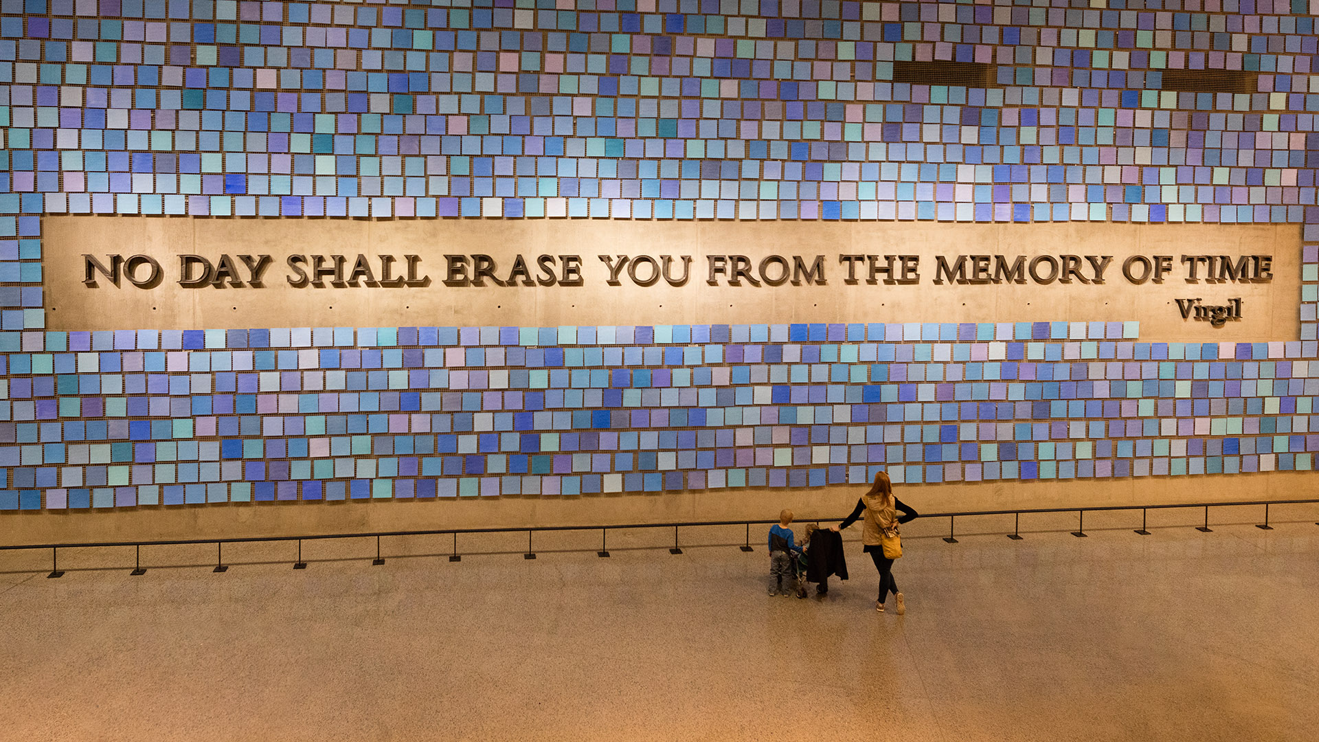 """No day shall erase you from the memory of time"" is a quote by Virgil that adorns a wall in the 911 Memorial Museum"