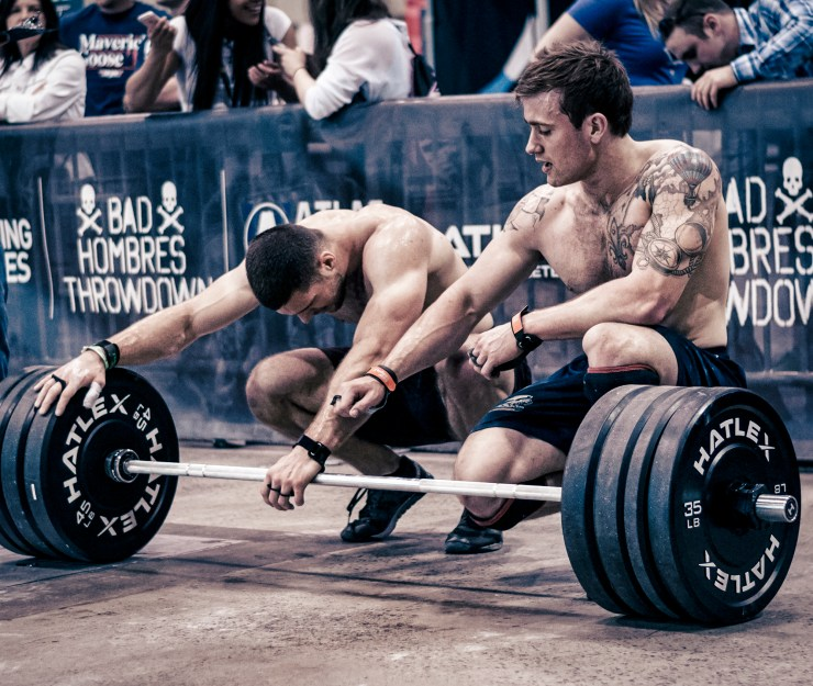 CrossFit athletes helping each other
