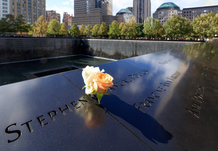 A lone rose decorates the name of one of the fallen at the 9/11 Memorial in New York City on October 23,2016