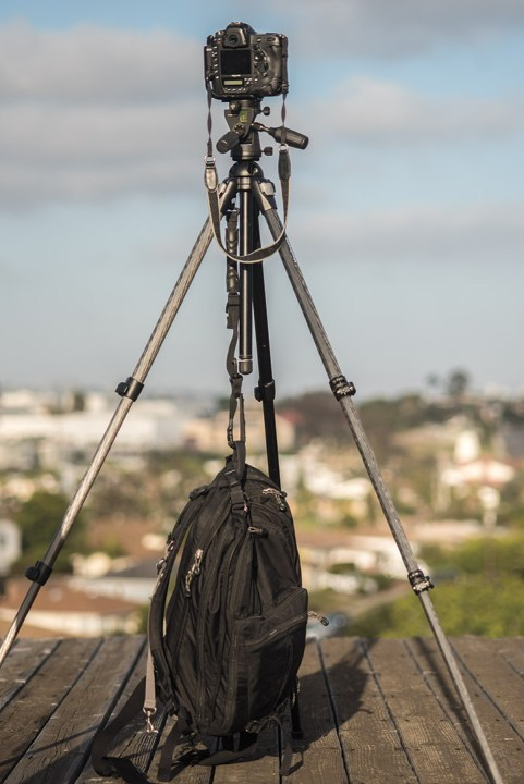 Hang a camera bag from the center column hook on a tripod for extra steadiness.