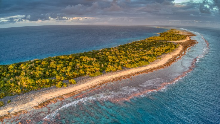 Aerial view of French Polynesian atoll at sunset