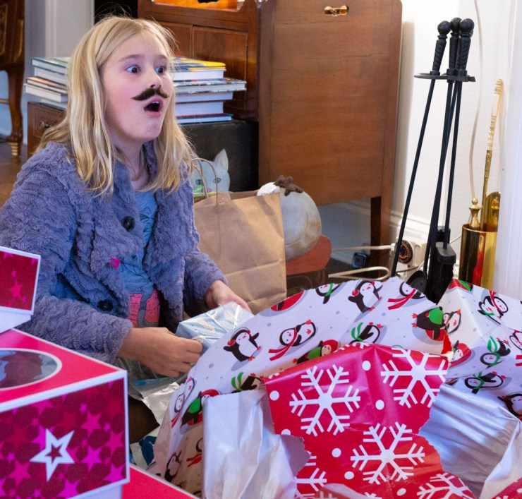 Opening presents on Christmas morning can be a wonderful, messy photo opportunity.