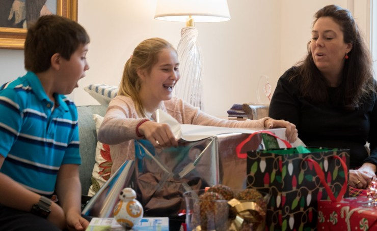 Excitement and joy of opening presents.