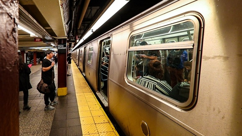 Waiting for the MTA in NYC. Photo by Kevin Ames