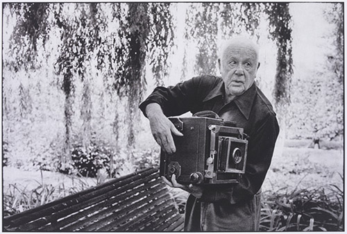 Paul Strand with camera in 1974. Photo by Maritne Franck.