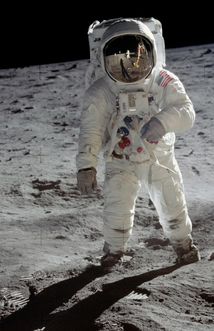 Buzz Aldrin, second man on the moon, photographed by Neil Armstrong. Armstrong's reflection shows in Aldrin's protective space helmet.
