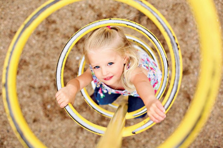 A high angle makes a dynamic photo of a child climbing a spiral ladder.