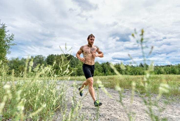 CrossFit athlete Stephane Cossette training running in the grass
