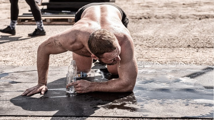 crossFit athlete dripping sweat after a hard workout training WOD