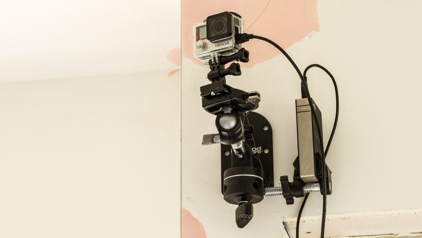The Platypod Ultra holds a GoPro for a time lapse sequence of installing hardwood flooring.
