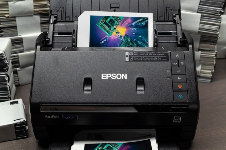 Load photos face up in the Epson FastFoto scanner