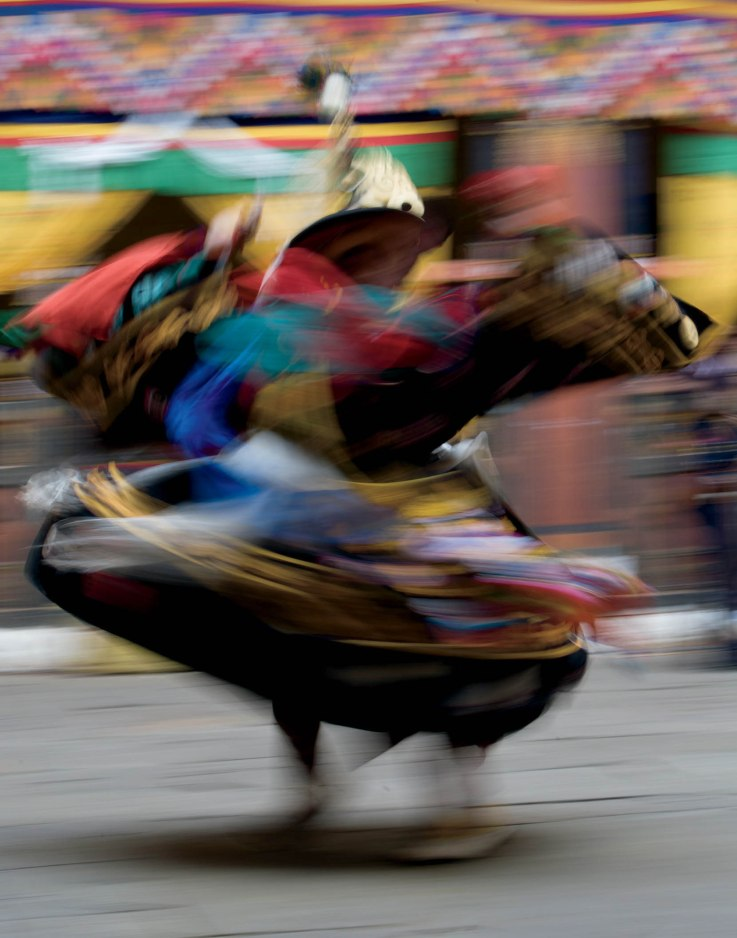 Try experimenting with different shutter speeds and moving subjects. This image, captured at 1/15s, was created by panning the camera with a dancing subject that was moving and spinning. 1/15 sec., f/16, ISO 200, Canon 5D, EF70-200mm f/2.8L IS USM @ 78mm