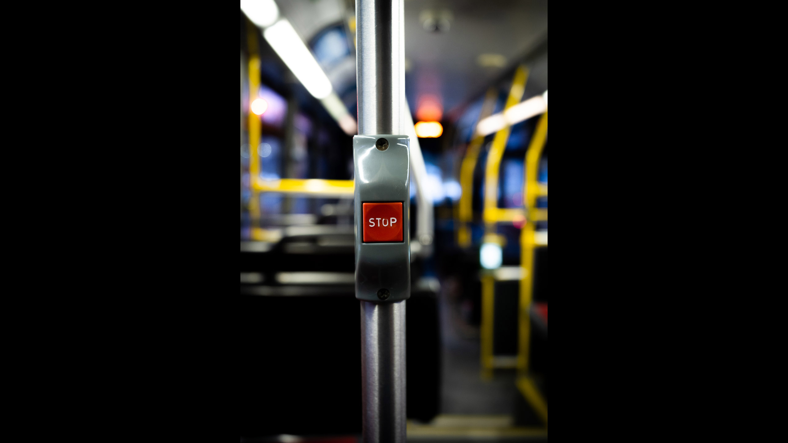 interior of a bus features the red stop button