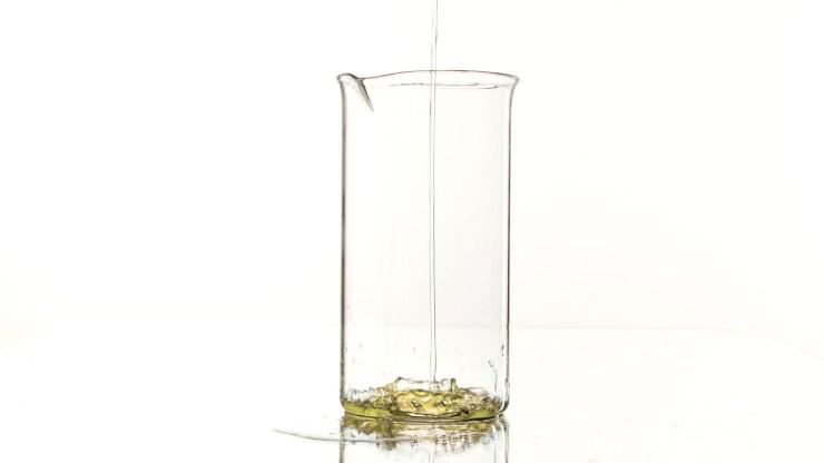 Pouring lemonade in a jar