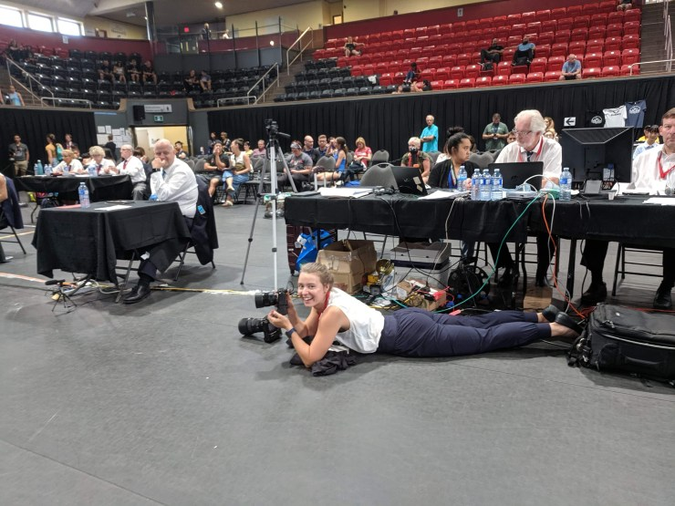 Photographer lying floor
