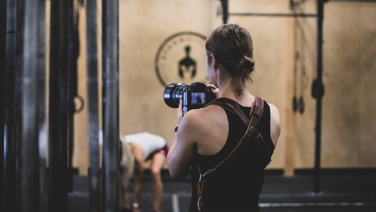 Female photographer in a gym