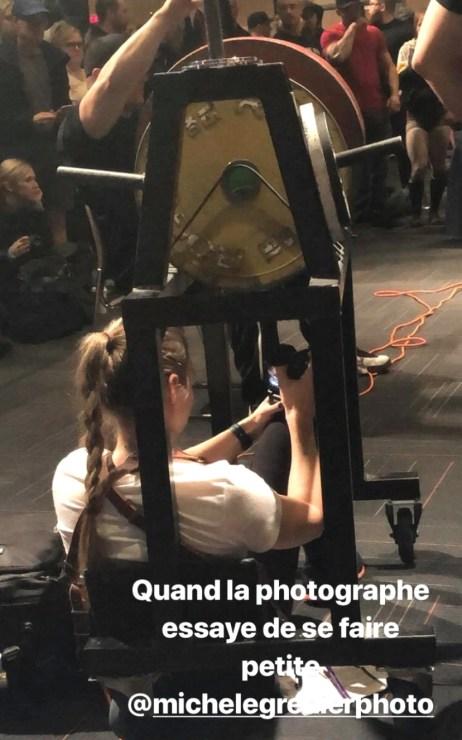 Female photographer strong man