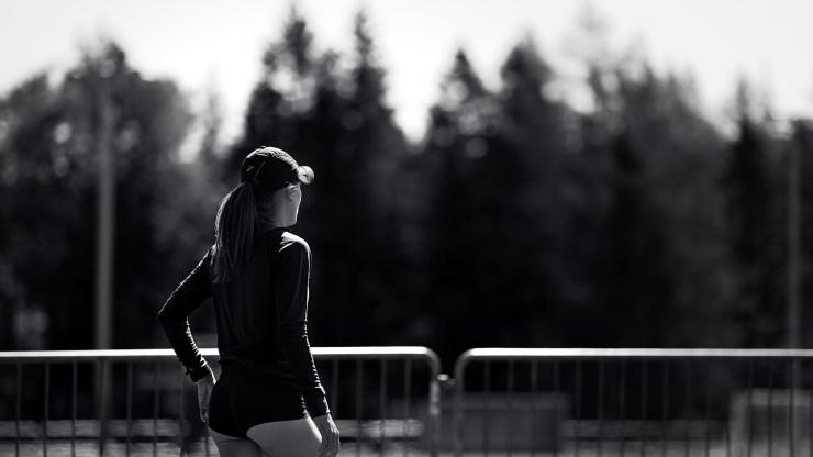 Female runner B&W blurred background