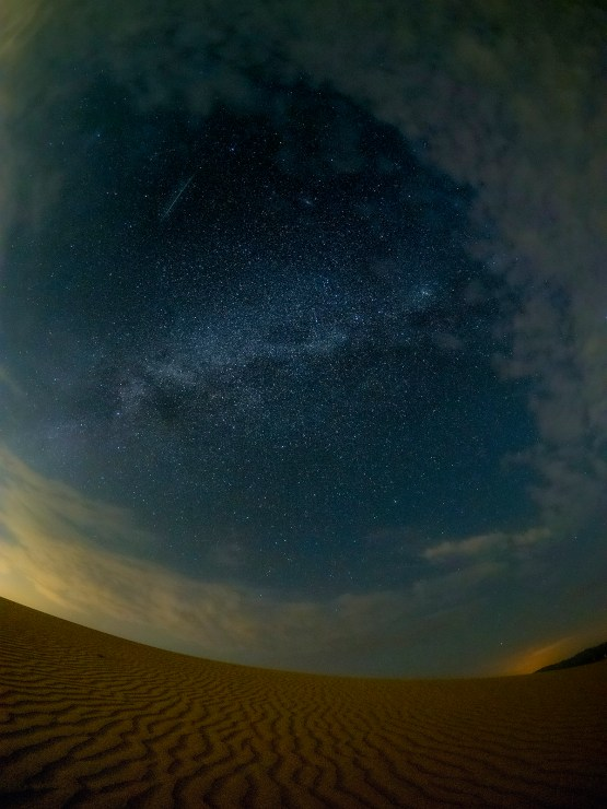Imperial desert dunes milky way and meteor photo
