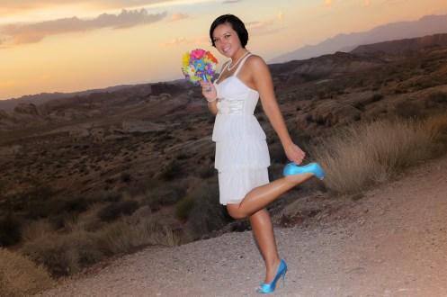 Photographers of Las Vegas - Wedding Photography - wedding bride at valley of fire bride grabbing heel