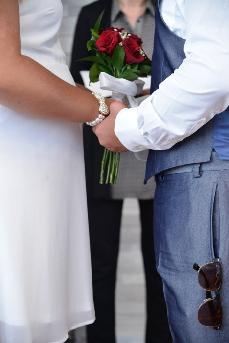 Photographers of Las Vegas - Wedding photography - holding hands and wedding flowers