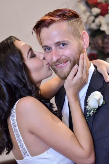 Photographers of Las Vegas - Wedding Photography - wedding couple bride kisses grooms cheek