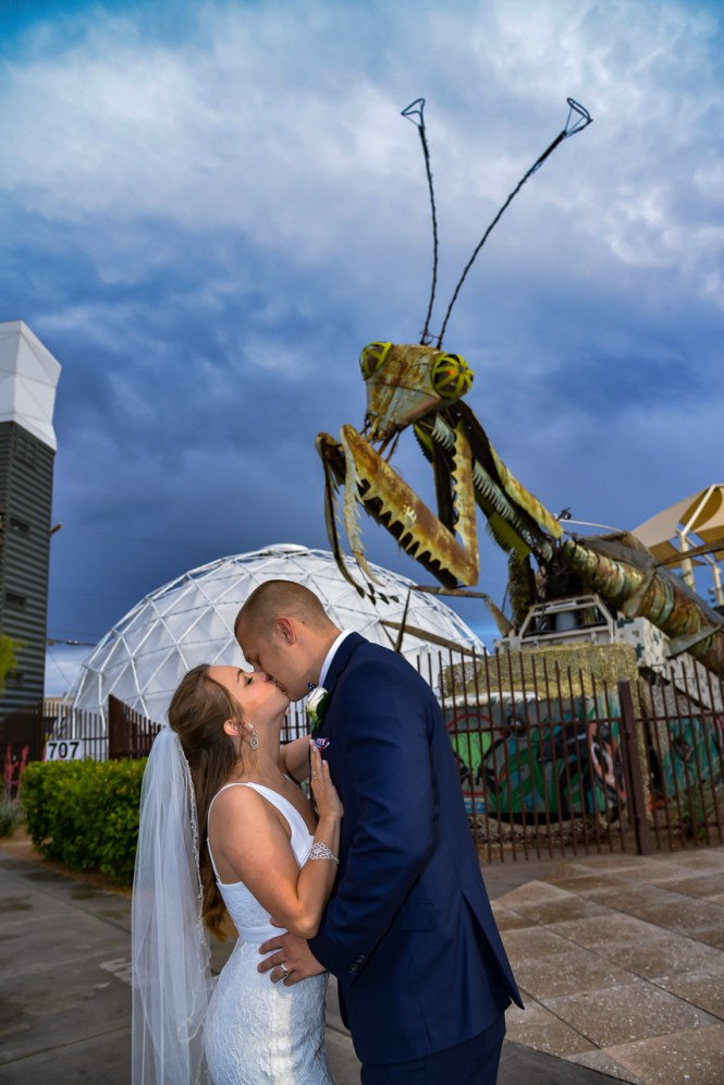 Photographers of Las Vegas - Vegas Strip Tour Photography - couple kiss in front of mantis at container park