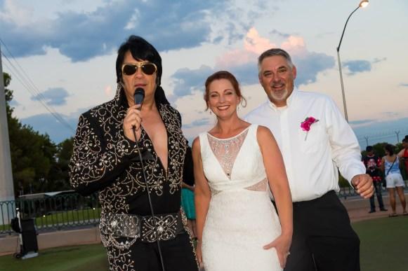 Photographers of Las Vegas - Vegas Strip Tour Photography - Elvis singing to wedding couple at The Welcome to Fabulous Las Vegas Sign