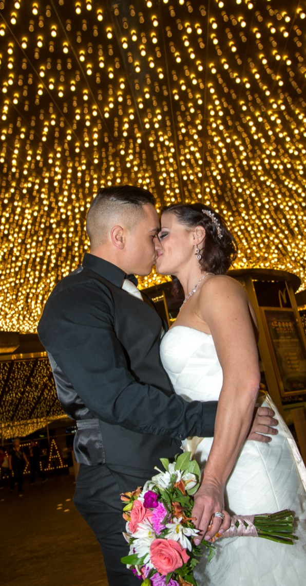 Photographers of Las Vegas - Wedding Photography - wedding couple kiss under Vegas lights