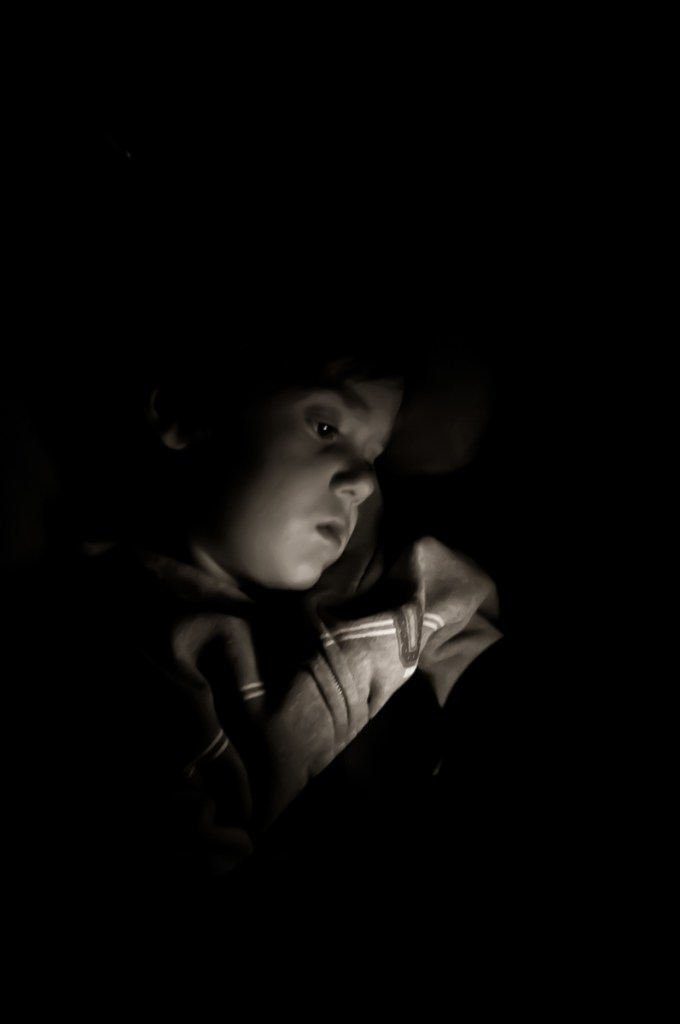 Photographers of Las Vegas - Portrait Photography - boy reading at night