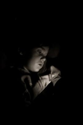 Photographers of Las Vegas - Portrait Photography - boy reading at night
