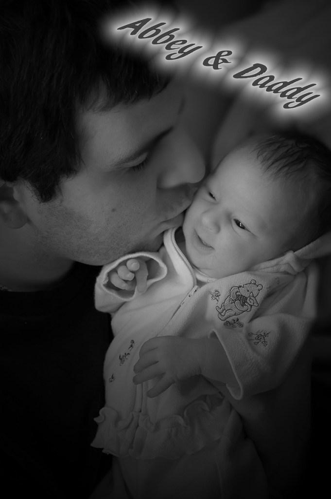 Photographers of Las Vegas - Portrait Photography - new dad with newborn
