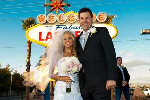 Photographers of Las Vegas - Wedding Photography - wedding bride and groom in front of sign background needed removal