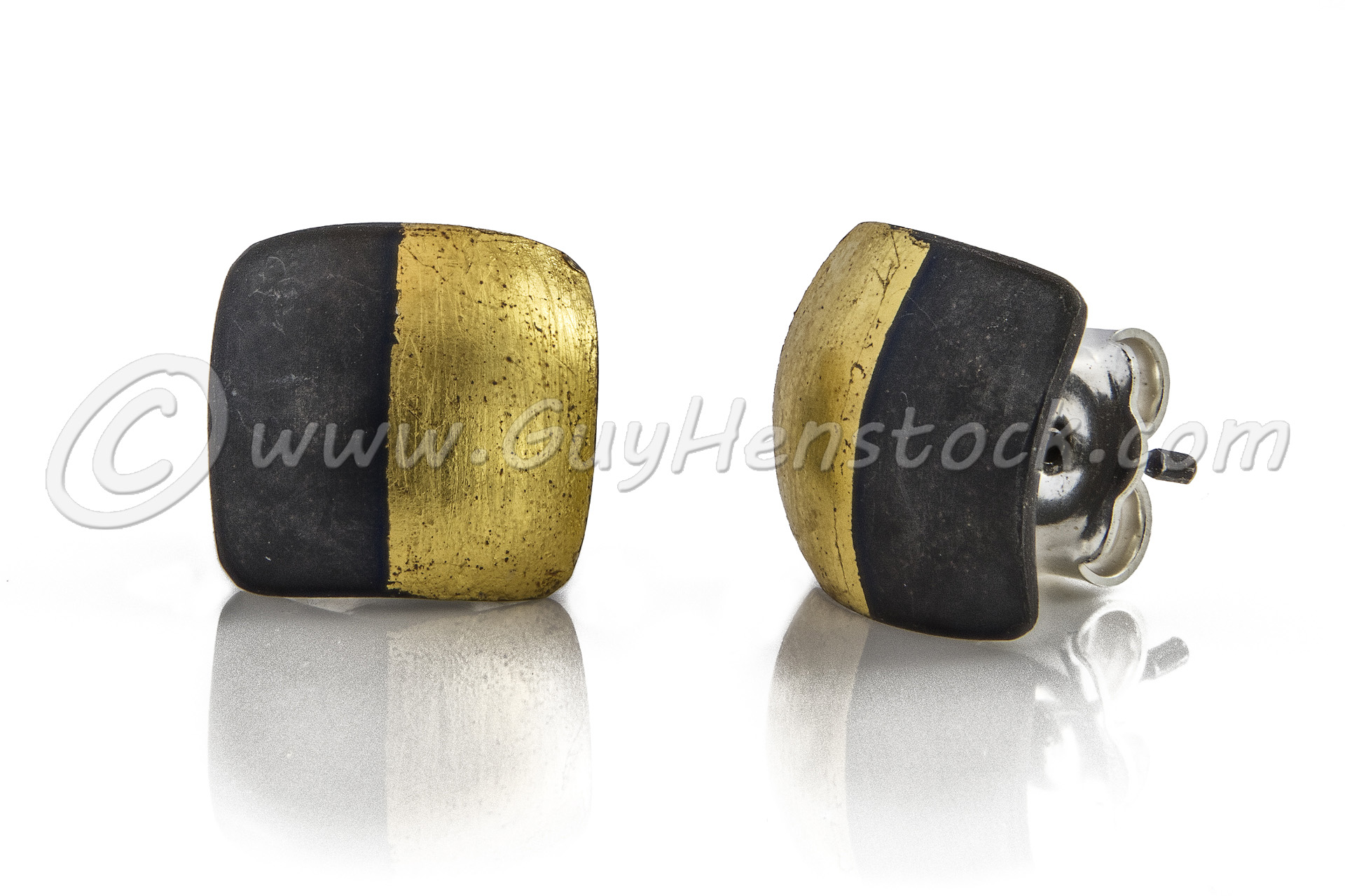 Gold and black earrings Product photography