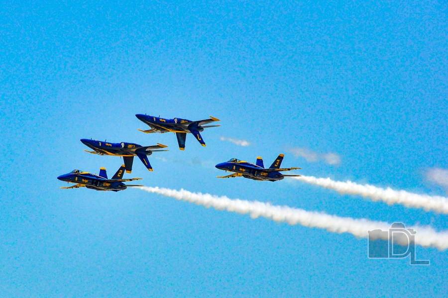The U.S. Navy Blue Angels perform a maneuver during an airshow in Sioux Falls, South Dakota.