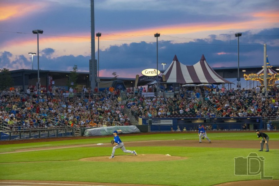 Las Vegas 51s pitcher Logan Verrett delivers a pitch as the sun sets during a AAA game between the 51s and the Omaha Stormchasers in Nebraska.