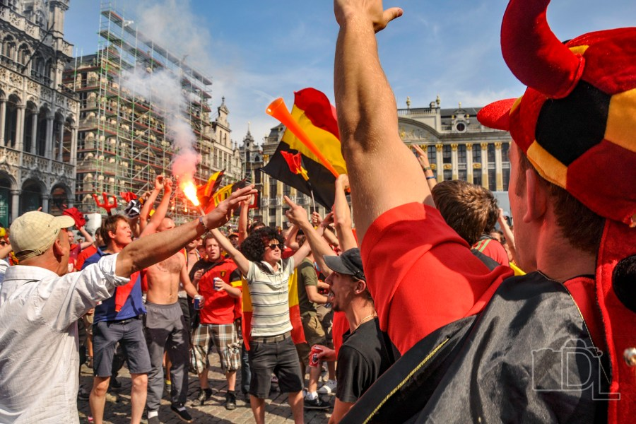Belgian football fans rally for their team in Grand Place in the city of Brussels.
