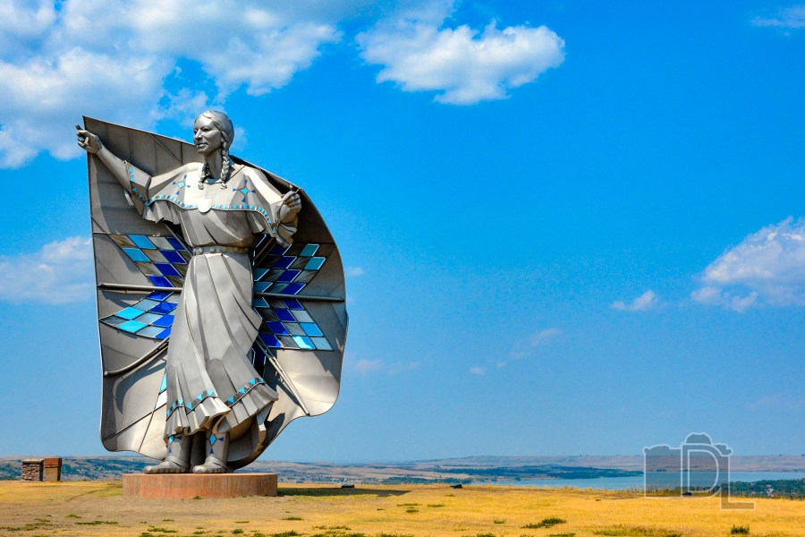 The Dignity statue created by sculptor Dale Lamphere sits atop a Missouri River bluff in Chamberlain, South Dakota.