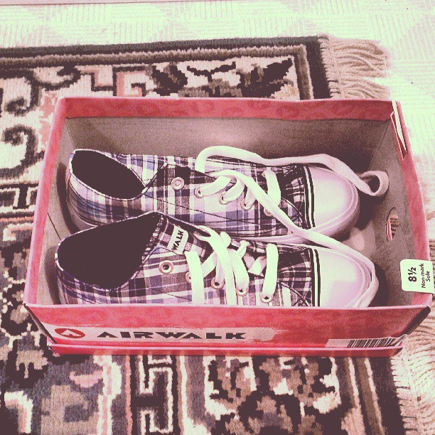 a photo of some plaid airwalk sneakers in their box