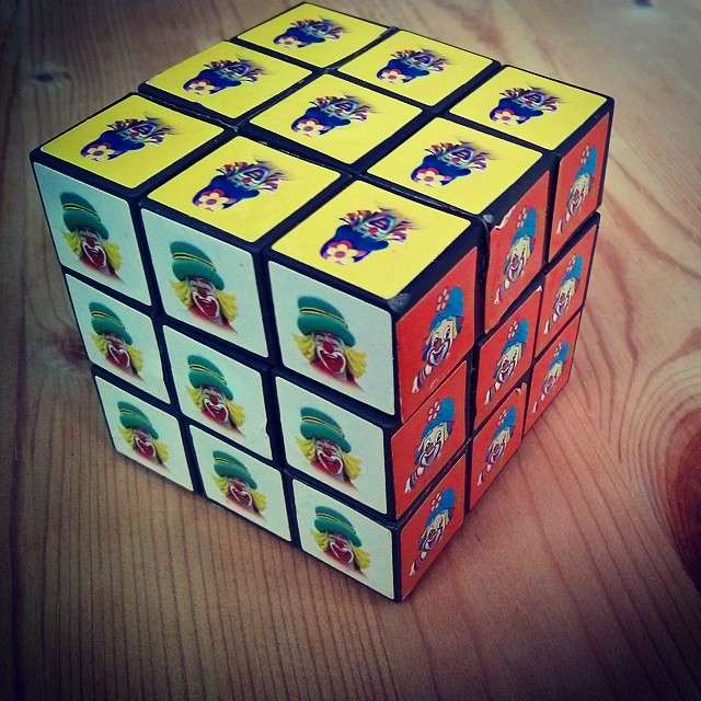 a photo of a rubik's cube with pictures of clown on all the squares