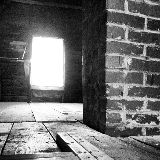 a black-and-white photo of an attic