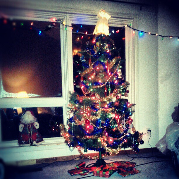a photo of a fully-decorated artificial christmas tree